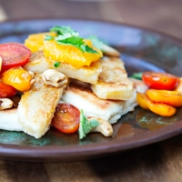 Salad of Vegan Halloumi and Tomatoes with Cashews and Potato Bread